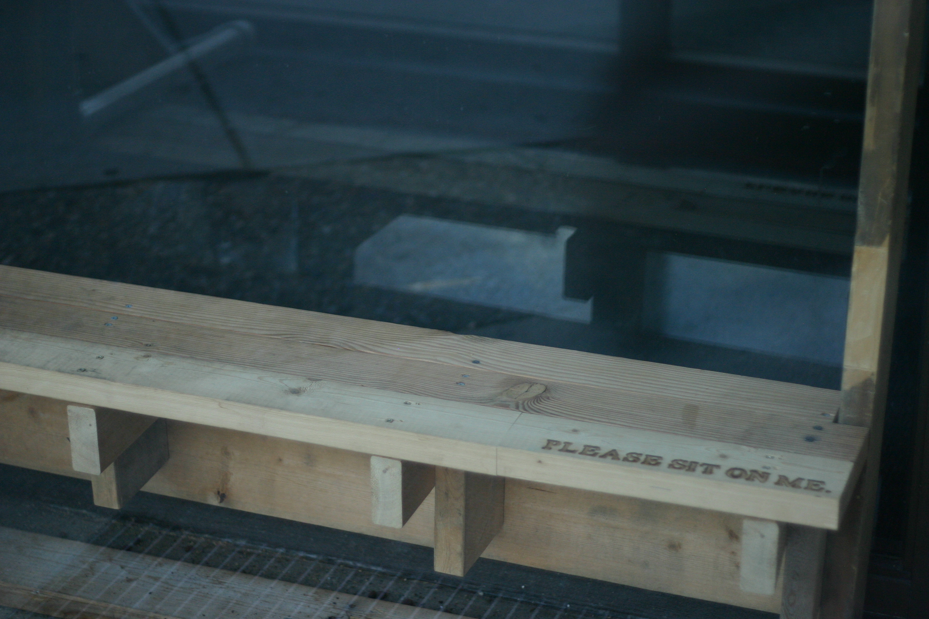 """""""Please Sit On Me"""" - the window farm bench invites passers-by to rest a while."""